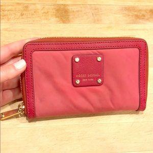 Henri Bendel zip around red nylon wallet